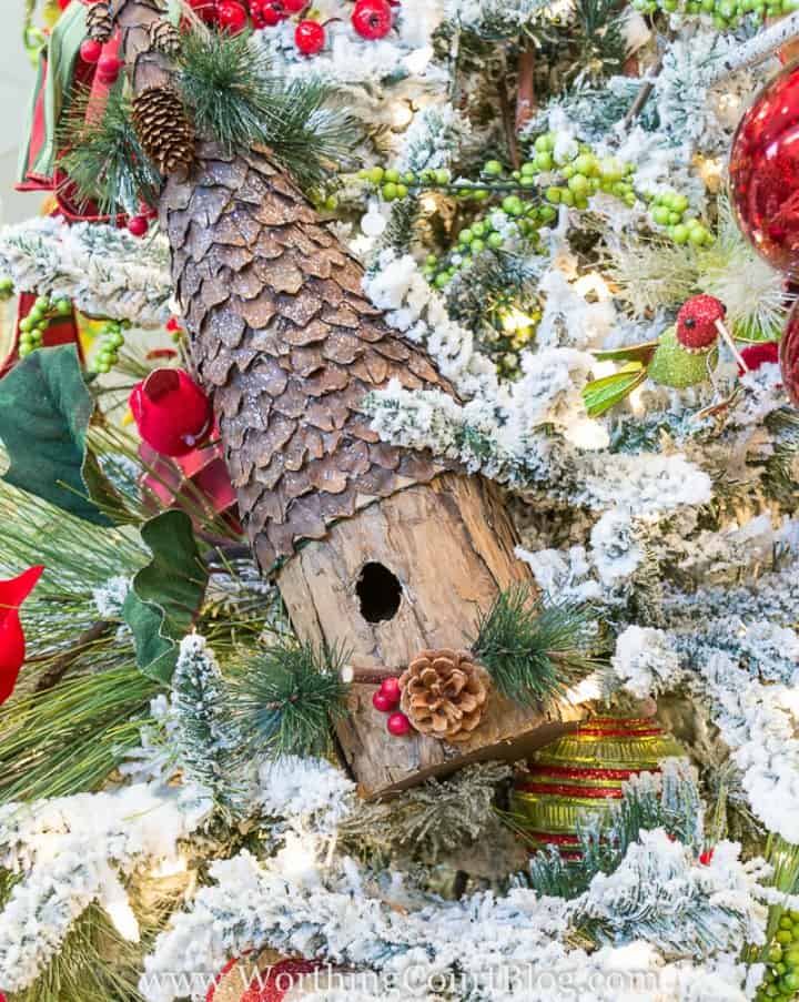 Large birdhouse wired to a Christmas tree