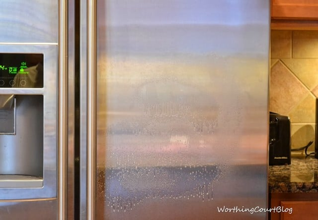 Worthing Court: Cleaning the stainless steel fridge with Steel Meister