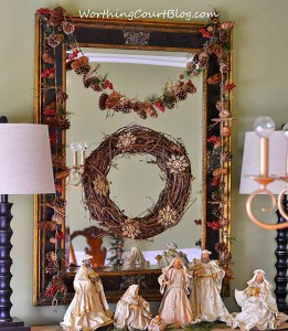 Nativity scene and Christmas decorations on the sideboard.