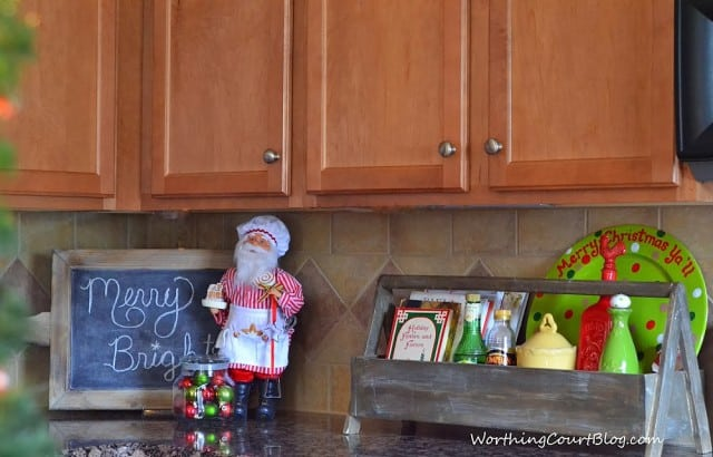 Worthing Court: Christmas vignette in my kitchen with a wooden toolbox, cooking Santa and a chalkboard