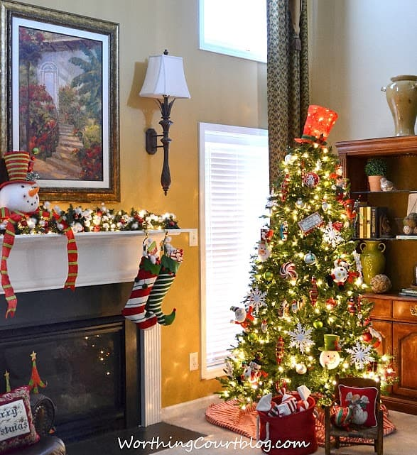 A fireplace mantel decorated for the holidays.