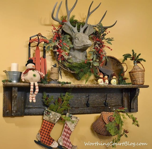 Worthing Court: Vintage mantel with faux deer head decorated for Christmas
