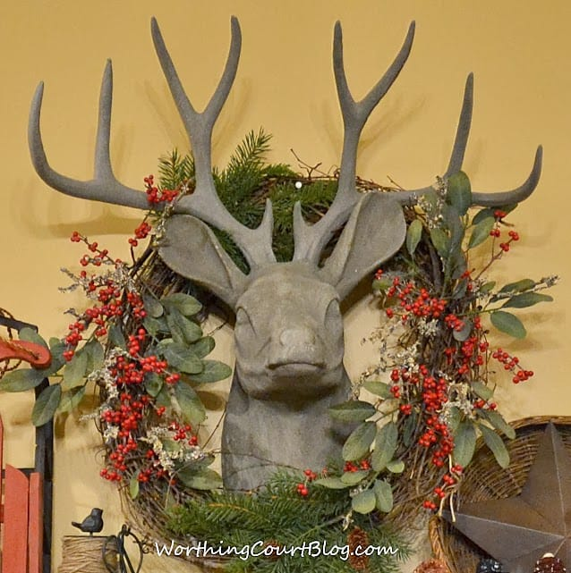 Worthing Court: Faux deer head with a Christmas wreath