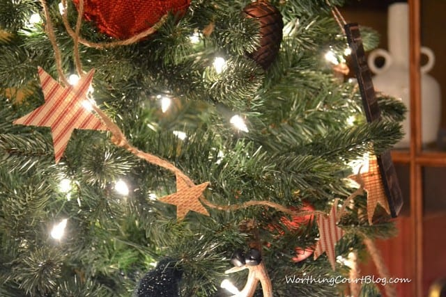 The star garland on the tree with white lights.