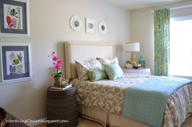 Worthing Court: Guest bedroom with calendar art, upside-down wicker hamper nightstand and calendar art