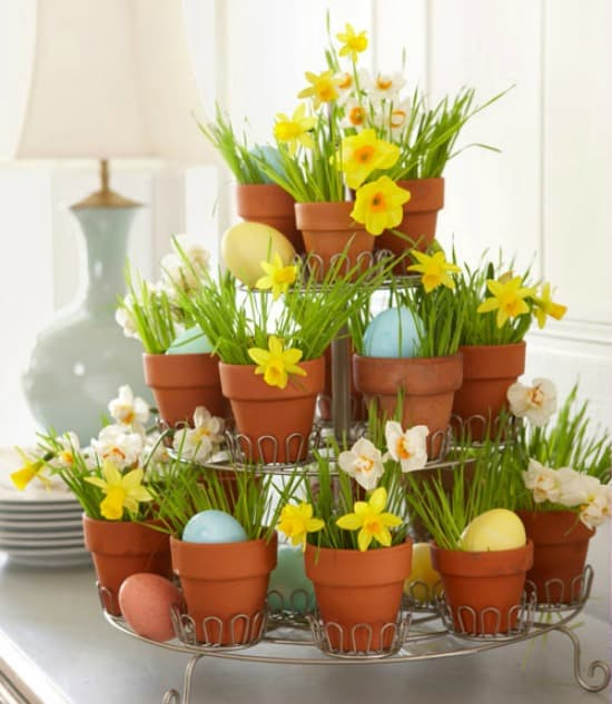 Mini pots displayed on a tiered cupcake stand are a great way to display spring flowers.