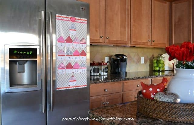 Countdown to Valentine's Day calendar mounted on the refrigerator with Command velcro strips