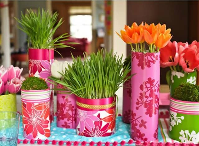 Wrap tin cans or containers from the dollar store with colorful wrapping paper and fill with spring flowers. Group them together for high impact!