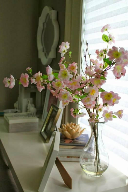 A single glass vase filled with cherry tree blossoms makes a lovely display of spring flowers.