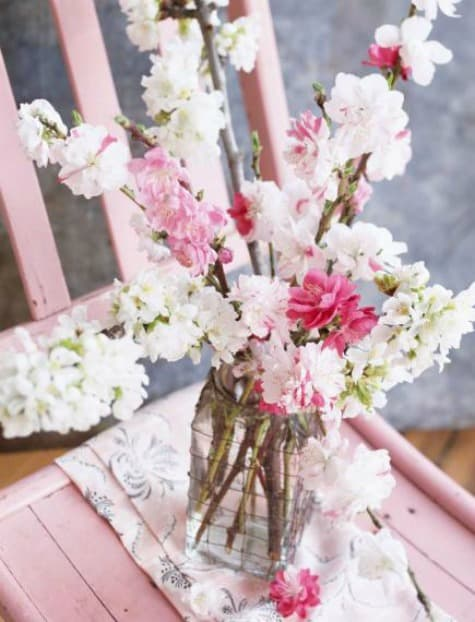 Blooming crabapple branches qualify as spring flowers too.  Fill a grouping of jars with flowering branches to create a pretty spring vignette.