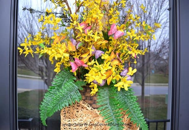 Nothing announces the arrival of spring more than when forsythia begins to bloom. Instead of a traditional wreath, fill a basket with faux forsythia stems and add a little something for color and greenery. Add ribbon to complete the welcoming arrangement. || Worthing Court Blog