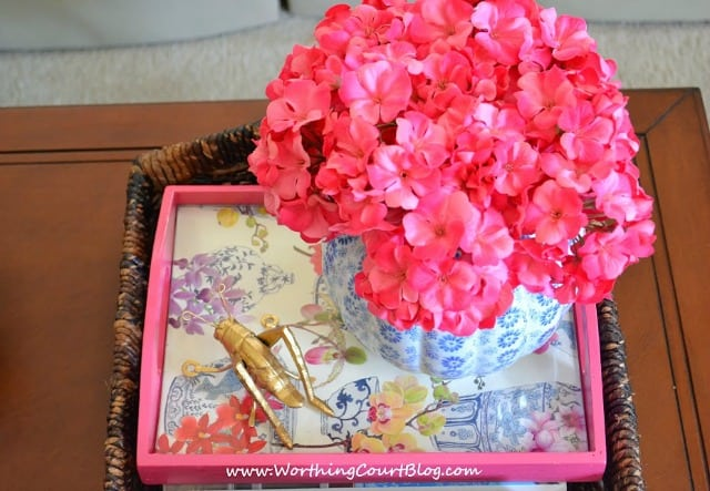 Inexpensive unfinished wood trays look great when made over with glossy spray paint, a piece of pretty wrapping paper and piece of glass cut to fit. :: WorthingCourtBlog.com