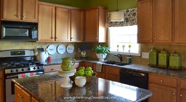 A DIY faux roman shade and other farmhouse touches in a kitchen