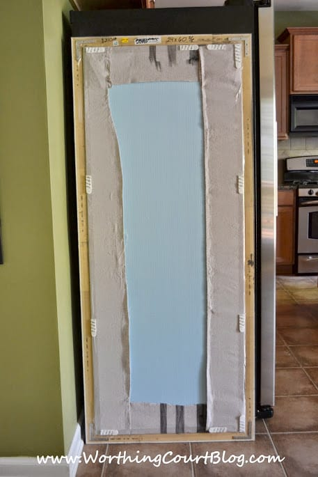 Backside of diy bulletin board that will be used to hide the side of a refrigerator