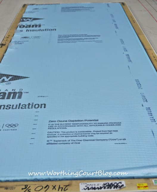 Sheet of exterior insulation cut to fit inside of a frame to be covered with fabric and serve as a bulletin board.