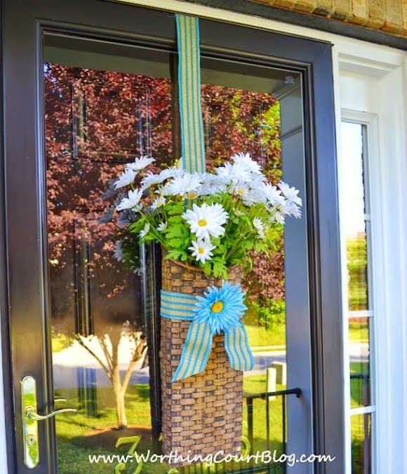 Summer door basket filled with daisies