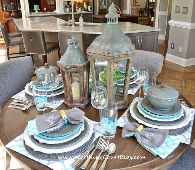 Beautiful and casual turquoise and gray table setting on a round table & Beautiful And Casual Round Table Setting - Worthing Court