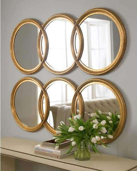 One simple thing room ideas - open up a room with multiple mirrors hanging together