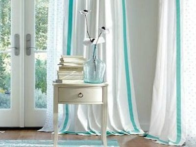 Adding ribbon to draperies is one simple thing you can do to complete the look of a room :: WorthingCourtBlog.com