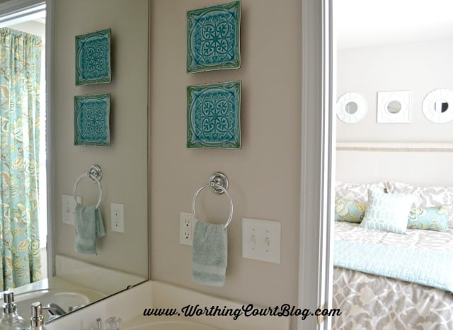 A neutral and aqua small bathroom with a beachy vibe