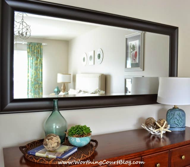 An oversized mirror visually enlarges a room