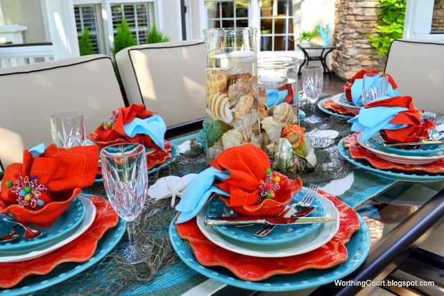 Outdoor dining at it's finest at a beautiful turquoise and coral tablescape