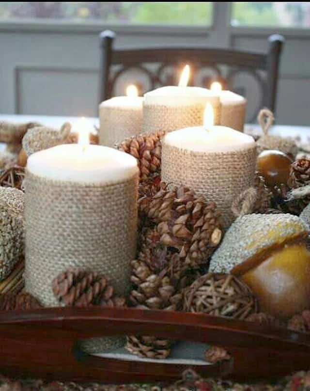 Bring in some warmth and texture for fall using burlap wrapped candles and pinecones to create an easy centerpiece.