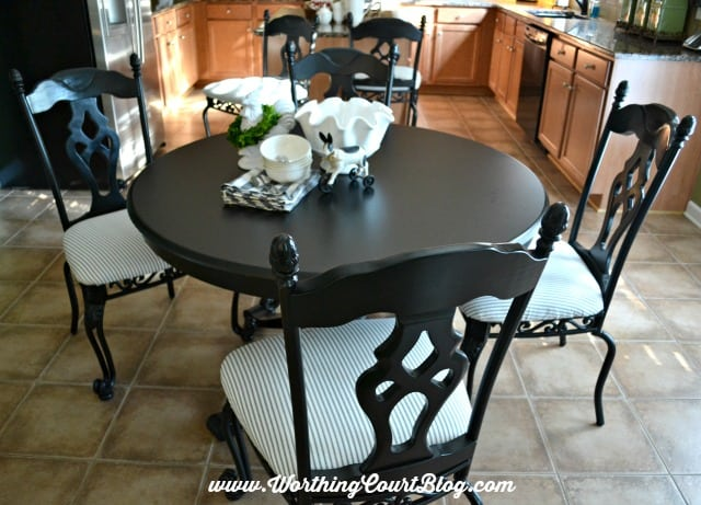 Kitchen chair makeover using black spray paint and black and white ticking fabric || WorthingCourtBlog.com