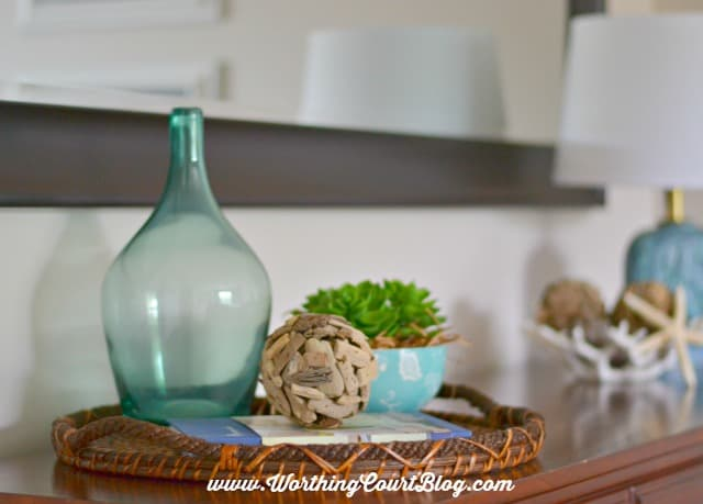 Grouping decorative items in a tray gives them importance || WorthingCourtBlog.com