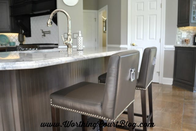 Barstools with polished nickel pulls and nailheads