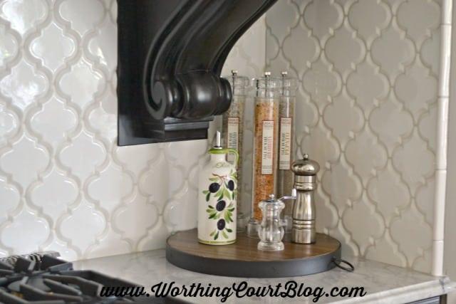 Large white arabesque shaped tile backsplash