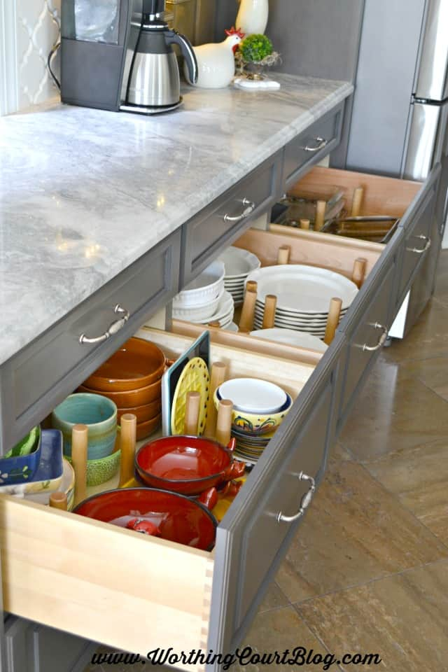 Peg organizers for kitchen drawers are moveable and keep dishes organized
