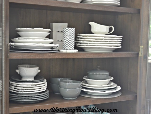Plates and accessories stacked and displayed in a cabinet in the kitchen