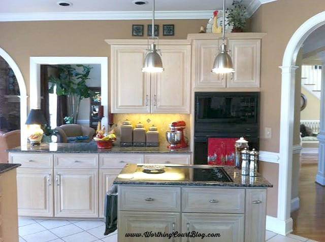 Tuscan look kitchen prior to remodeling. See the amazing after at WorthingCourtBlog.com