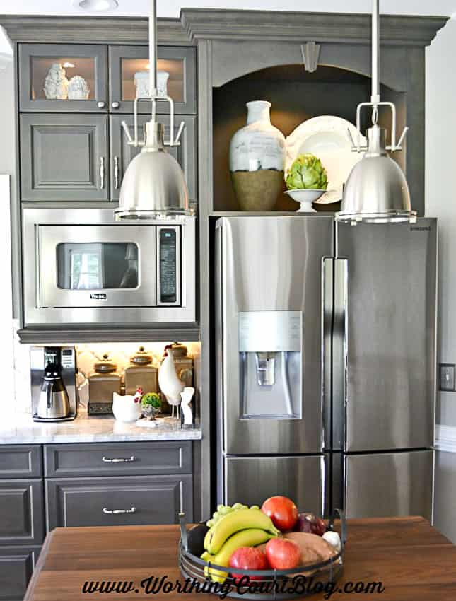 A large display space above a refrigerator makes a great area to showcase special accessories || Worthing Court