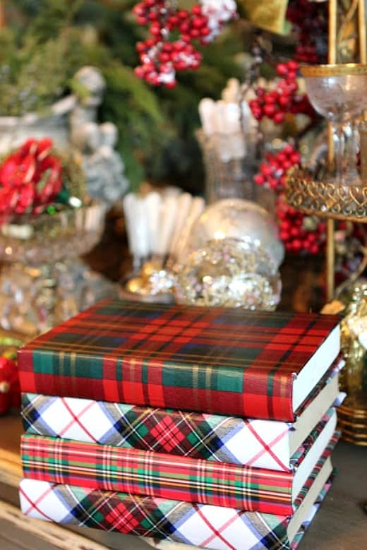 Wrap a few book with plaid wrapping paper to add a touch of plaid to any room.