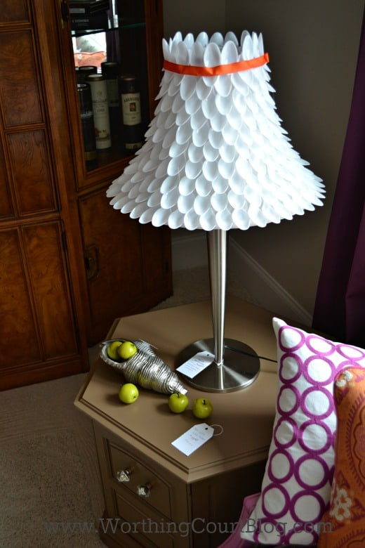 Cover a lampshade with plastic spoons
