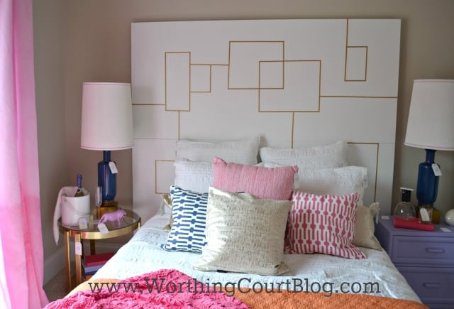 Headboard made of two doors, one stacked on the top of the other with small pieces of gold painted wood applied
