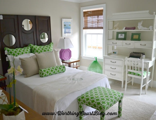 A bedroom with both mid-century modern and preppy design elements