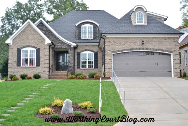 Exterior of brick transitional style house