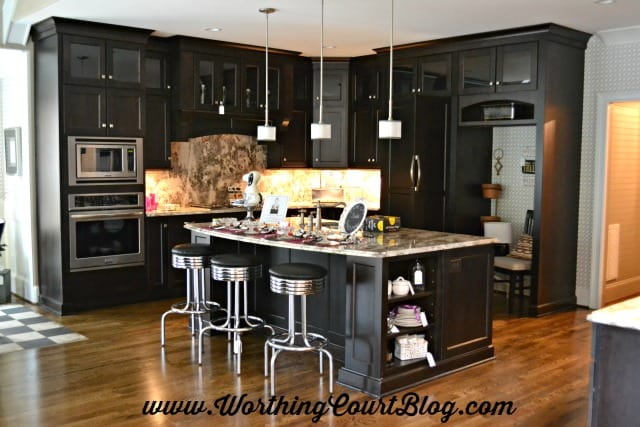 Kitchen with black cabinets decorated with mid-century modern details
