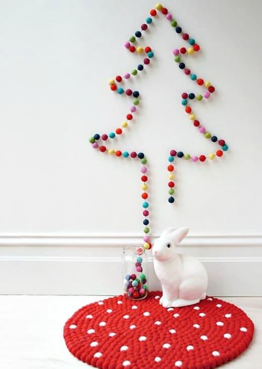A diy Christmas tree using a pompom garland