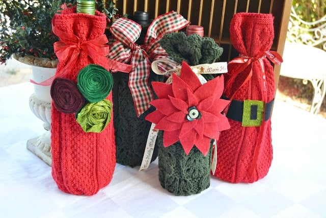 Red and green wine bottle cozies with floral details.