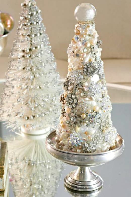 Cover a tree shaped piece of foam with vintage costume jewelry for a one of a kind diy Christmas tree