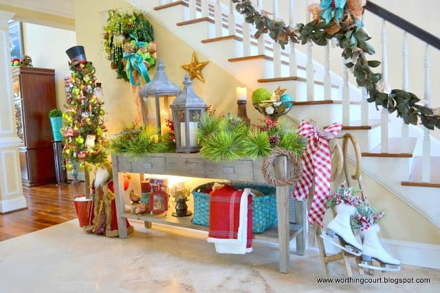 A foyer beautifully decorated for Christmas. What a great way to greet your guests!