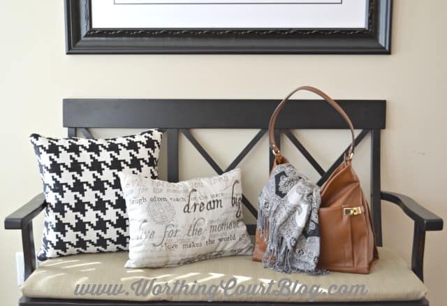 A bench in the kitchen is a great place to display pretty pillows.