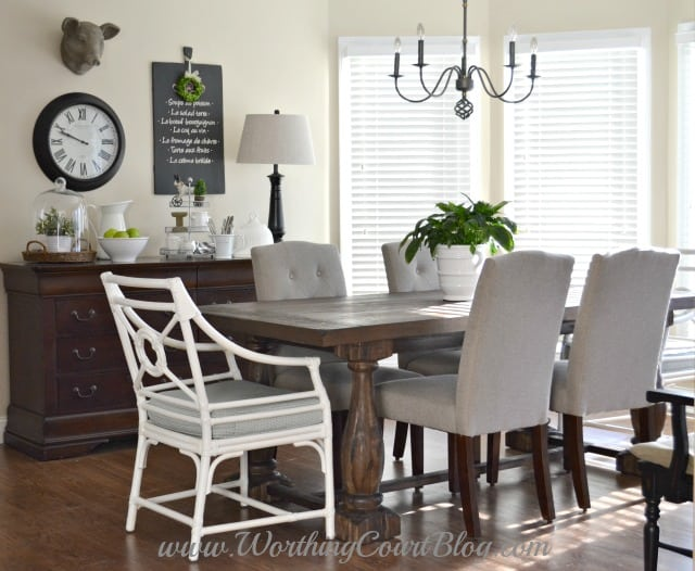Farmhouse kitchen table, chairs and vignette. The dresser holds kitchen towels, aprons and table linens.