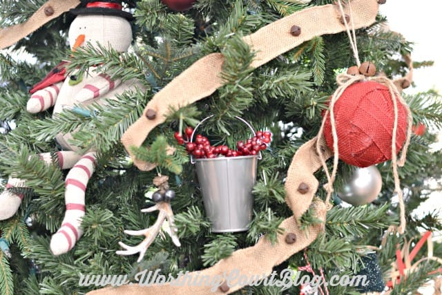 Burlap ribbon adorned with jingle bells makes a great garland for a rustic Christmas tree