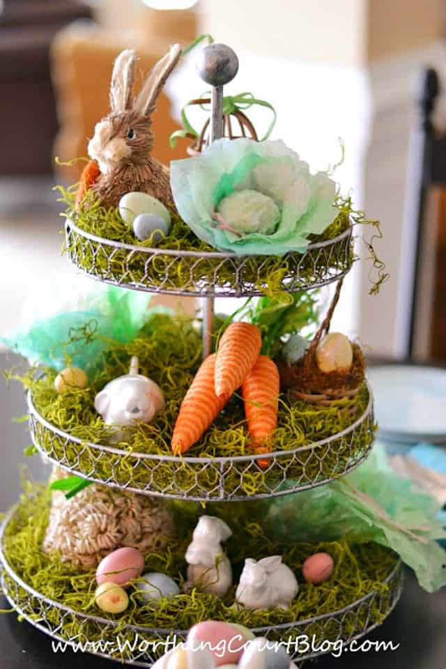 Easter centerpiece on a tiered stand with diy coffee filter heads of lettuce