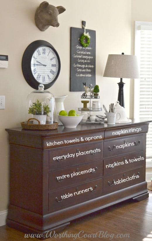 Use a dresser in the kitchen to hold kitchen & dining linens, act as a sideboard and to display your pretties.